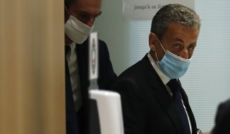 Former French President Nicolas Sarkozy leaves the courtroom in Paris, Monday, March 1, 2021. (AP Photo/Michel Euler)
