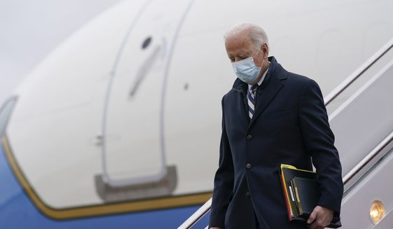 President Joe Biden steps off Air Force One at Andrews Air Force Base, Md., Monday, March 1, 2021. Biden is returning to Washington after spending the weekend at his home in Delaware. (AP Photo/Patrick Semansky)