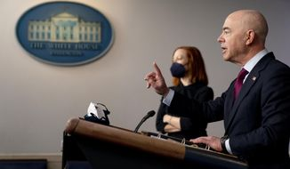 Homeland Security Secretary Alejandro Mayorkas, right, accompanied by White House press secretary Jen Psaki, left, speaks during a press briefing at the White House, Monday, March 1, 2021, in Washington. (AP Photo/Andrew Harnik)