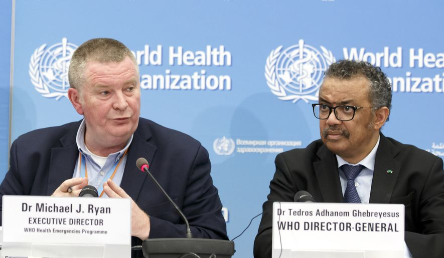 In this Monday, Feb. 24, 2020 file photo, Michael Ryan, left, Executive Director of WHO's Health Emergencies programme, next to Tedros Adhanom Ghebreyesus, right, Director General of the World Health Organization (WHO), addresses a press conference about the update on COVID-19 at the World Health Organization headquarters in Geneva, Switzerland.  (Salvatore Di Nolfi/Keystone via AP, File)  **FILE**