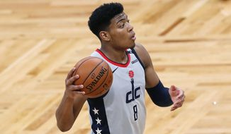 Washington Wizards' Rui Hachimura plays against the Boston Celtics during the first half of an NBA basketball game, Sunday, Feb. 28, 2021, in Boston. (AP Photo/Michael Dwyer) **FILE**