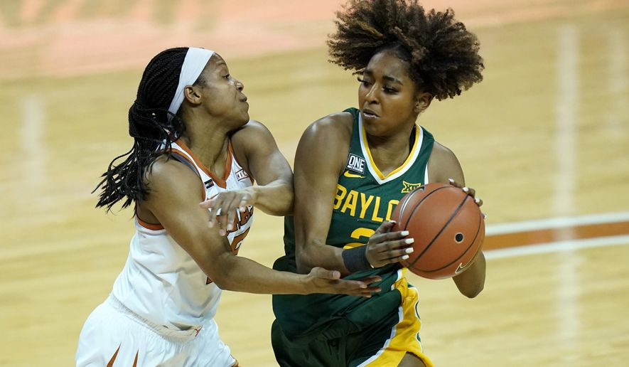 Baylor guard DiDi Richards (2) is pressured by Texas guard Kyra Lambert (15) during the first half of an NCAA college basketball game, Monday, March 1, 2021, in Austin, Texas. (AP Photo/Eric Gay)