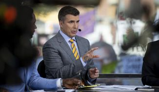 FILE - ESPN College Game Day's Rece Davis gestures while talking on the set in College Station, Texas before the start of an NCAA college football game between Clemson and Texas A&M, in this  Saturday, Sept. 8, 2018, file photo. ESPN has re-signed Rece Davis to a multiyear contract that will keep him in place as the host of the network's popular Saturday college football pregame show. The network announced the deal Monday, March 1, 2021. (AP Photo/Sam Craft, File)