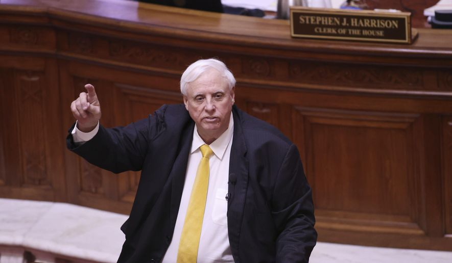 West Virginia Gov. Jim Justice speaks during the State of the State Address in the House Chambers of the West Virginia State Capitol Building in Charleston, W.Va., on Wednesday, Feb. 10, 2021. (AP Photo/Chris Jackson, File)