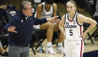 Connecticut head coach Geno Auriemma, left, talks with guard Paige Bueckers (5) during a break in the first quarter against Marquette during an NCAA college basketball game Monday, March 1, 2021, in Storrs, Conn. (David Butler II/Pool Photo via AP)