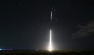 This Dec. 10, 2018, file photo, provided by the U.S. Missile Defense Agency (MDA), shows the launch of the U.S. military's land-based Aegis missile defense testing system, that later intercepted an intermediate-range ballistic missile, from the Pacific Missile Range Facility on the island of Kauai in Hawaii.  (Mark Wright/Missile Defense Agency via AP)  **FILE**
