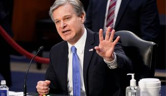 """""""Jan. 6 is not an isolated incident. The problem of domestic terrorism isn't going away,"""" FBI Director Christopher A. Wray said. (Associated Press)"""