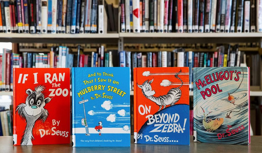 """""""If I Ran the Zoo,"""" """"And to Think That I Saw It on Mulberry Street,"""" """"On Beyond Zebra!"""" and """"McElligot's Pool"""" are among the six Dr. Seuss childrens' books, that will no longer be published. """"Scrambled Eggs Super!"""" and """"The Cat's Quizzer"""" are the other two. Dr. Seuss Enterprises cited insensitivity as a factor in the decision. displayed at the North Pocono Public Library in Moscow, Pa., Tuesday, March 2, 2021. Dr. Seuss Enterprises, the business that preserves and protects the author's legacy said Tuesday, that these four titles, as well as Scrambled Eggs Super!, and The Cats Quizzer, will no longer be published because of racist and insensitive imagery. (Christopher Dolan/The Times-Tribune via AP) (ASSOCIATED PRESS)"""
