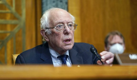 Sen. Bernie Sanders, I-Vt., chairman of the Senate Budget Committee, speaks during a hearing to examine the nomination of Shalanda Young to be deputy director of the Office of Management and Budget on Capitol Hill in Washington, Tuesday, March 2, 2021. (AP Photo/Patrick Semansky)  ** FILE **