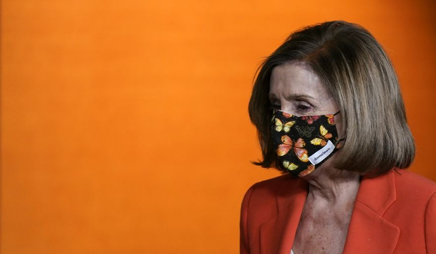 House Speaker Nancy Pelosi of Calif., walks to a lectern to answer a reporter's question during a news conference before participating in the House Democratic Issues Conference on Capitol Hill in Washington, Tuesday, March 2, 2021. (AP Photo/Patrick Semansky) **FILE**