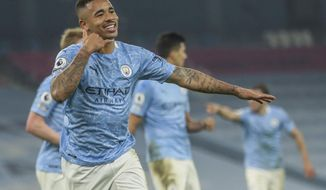 Manchester City's Gabriel Jesus celebrates after scoring his team second goal during the English Premier League soccer match between Manchester City and Wolves at the Etihad stadium in Manchester, England, Tuesday, March 2, 2021. (Carl Recine/Pool via AP)