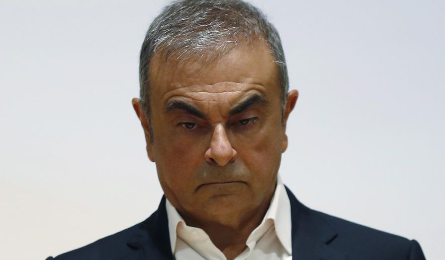FILE - In this Sept. 29, 2020, file photo, former Nissan Motor Co. Chairman Carlos Ghosn holds a press conference at the Maronite Christian Holy Spirit University of Kaslik, as he launches an initiative to help Lebanon that is undergoing a severe economic and financial crisis, in Kaslik, north of Beirut, Lebanon. Two Americans suspected  of helping Ghosn skip bail and escape to Lebanon in December 2019 have been extradited to Japan. Michael Taylor and his son Peter were handed over to Japanese custody on Monday, March 1, 2021 and were due to arrive in Tokyo on Tuesday.  (AP Photo/Hussein Malla, File)