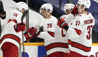 Carolina Hurricanes center Sebastian Aho (20) is congratulated as he leaves the ice after an NHL hockey game against the Nashville Predators Tuesday, March 2, 2021, in Nashville, Tenn. Aho scored twice as the Hurricanes won 4-2. (AP Photo/Mark Humphrey)