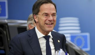 FILE - In this file photo dated Saturday, July 18, 2020, Dutch Prime Minister Mark Rutte arrives for an EU summit at the European Council building in Brussels.  The Netherlands is holding a general election over three days starting March 15 2021 because of fears that busy polling stations could spike infections, which comes after Prime Minister Mark Rutte has spent more than a decade in power. (AP Photo/Olivier Matthys, file)