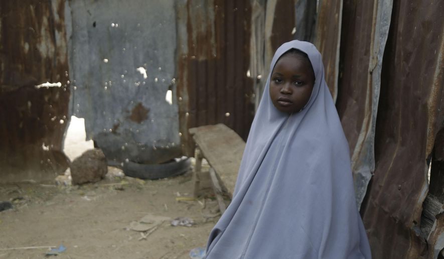 Student Amtallahi Lawal, 11, who hid under her bed and managed to escape when gunmen abducted more than 300 girls from her boarding school on Friday, recounts her ordeal at her house in Jangebe town, Zamfara state, northern Nigeria, Monday, March 1, 2021. Families in Nigeria waited anxiously on Monday for news of their abducted daughters, the latest in a series of mass kidnappings of school students in the West African nation. (AP Photo/Sunday Alamba)
