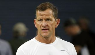 FILE - In this Sunday, Dec. 15, 2019, file photo, Los Angeles Rams' Joe Barry watches before an NFL football game against the Dallas Cowboys in Arlington, Texa,. Green Bay Packers defensive coordinator Jon Barry understands the questions about his track record. Barry has been a defensive coordinator twice before with Detroit and Washington, and his defenses ranked near or at the bottom of the league in many statistical categories. He followed that up with a successful four-year stint as the Los Angeles Rams' linebackers coach.  (AP Photo/Michael Ainsworth, File)