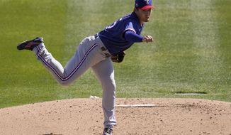 Texas Rangers starting pitcher Kohei Arihara, of Japan, throws a pitch against the Chicago White Sox during the first inning of a spring training baseball game Tuesday, March 2, 2021, in Phoenix. (AP Photo/Ross D. Franklin)
