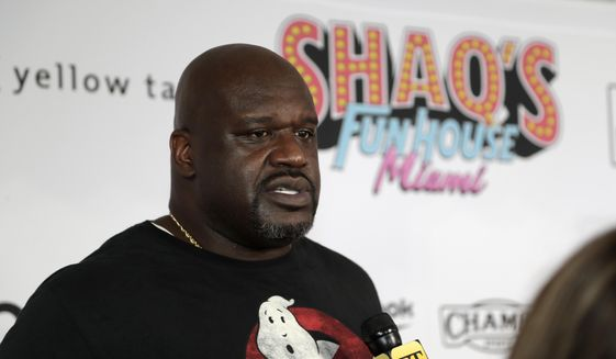 """In this Jan. 31, 2020, file photo, former NBA player Shaquille O' Neal is interviewed on the red carpet for Shaq's Fun House in Miami. O'Neal is set to perform in his first competitive match when he teams in All Elite Wrestling with Jade Cargill in a mixed tag to take on Cody Rhodes and Red Velvet at Daily's Place on an episode of """"Dynamite"""" Wednesday, March 3, 2021. (AP Photo/Lynne Sladky, File) **FILE**"""