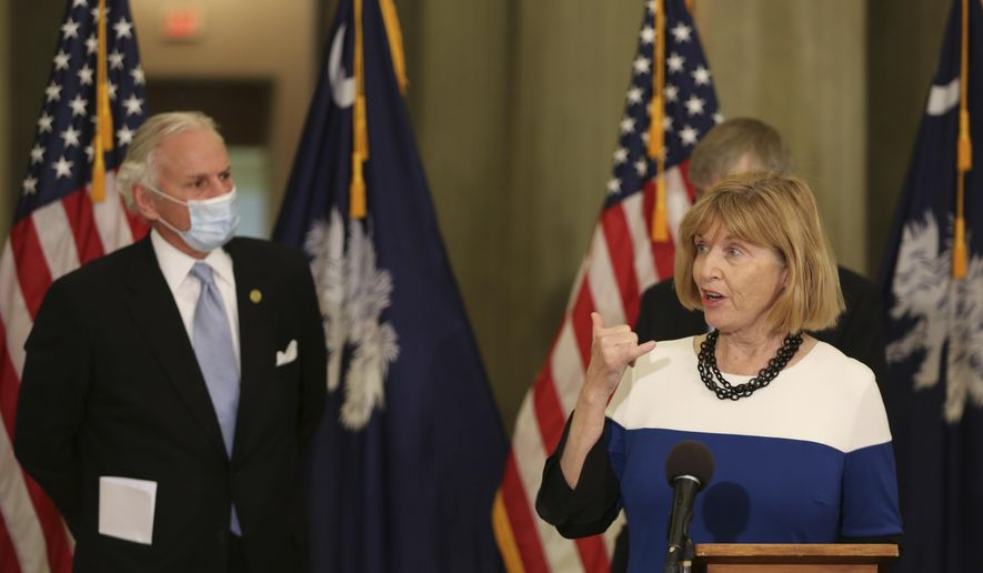 South Carolina Education Superintendent Molly Spearman, right, and Gov. Henry McMaster, left, discuss the state opening up vaccines for more people at a news conference on Tuesday, March 2, 2021, in Columbia, S.C.  Officials announced the majority of people in the state, including teachers and people 55 and older, can get the coronavirus vaccine starting next week. (AP Photo/Jeffrey Collins)