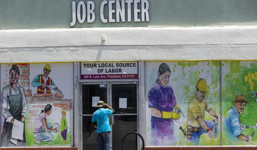 In this May 7, 2020, file photo, a person looks inside the closed doors of the Pasadena Community Job Center in Pasadena, Calif., during the coronavirus outbreak. A state report released Tuesday, March 2, 2021, details the pandemic's toll on California workers and shines light on who was most affected by job losses and layoffs. (AP Photo/Damian Dovarganes, File)