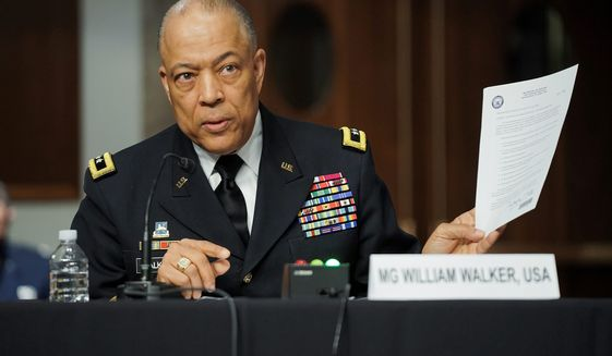 Army Maj. Gen. William Walker, Commanding General of the District of Columbia National Guard, answers questions during a joint hearing on Wednesday about the Jan. 6 attack on the U.S. Capitol. (Associated Press)