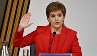 First Minister of Scotland Nicola Sturgeon takes the oath before giving evidence to the Committee on the Scottish Government Handling of Harassment Complaints, at Holyrood in Edinburgh, Scotland, Wednesday, March 3, 2021.  The inquiry is investigating the government's handling of sexual harassment allegations against former leader Alex Salmond, and allegations that Sturgeon misled parliament. (Jeff J Mitchell/PA via AP)