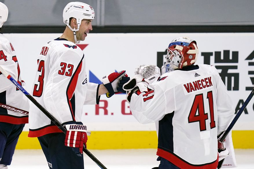 Washington Capitals goaltender Vitek Vanecek (41) is congratulated by Zdeno Chara following a shootout against the Boston Bruins during an NHL hockey game, Wednesday, March 3, 2021, in Boston. The Capitals won 2-1. (AP Photo/Charles Krupa)