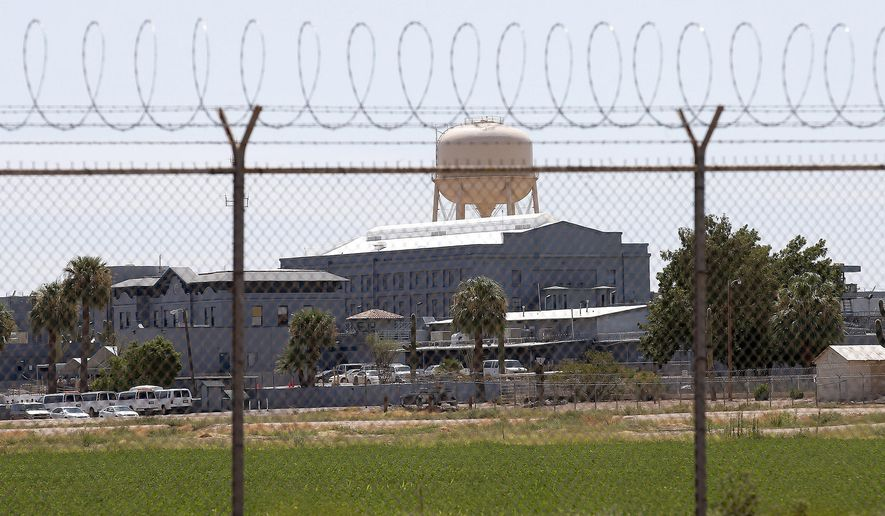 FILE - This July 23, 2014, file photo, shows a state prison in Florence, Ariz. A female Arizona corrections officer alleged in a lawsuit filed against the state on March 2, 2021, that she was subjected to a hostile environment while working at a prison where her supervisor was accused of sexually assaulting her and three other people who worked there. Corrections officials say their investigators arrested the officer after they examined the allegations and then sent the case to prosecutors. (AP Photo/File)