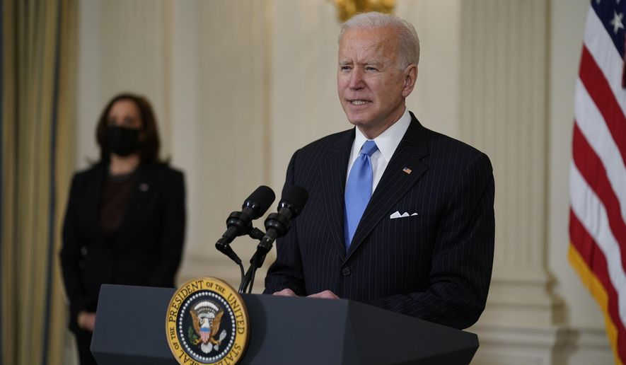 President Joe Biden, accompanied by Vice President Kamala Harris, speaks about efforts to combat COVID-19, in the State Dining Room of the White House, Tuesday, March 2, 2021, in Washington. (AP Photo/Evan Vucci) ** FILE **