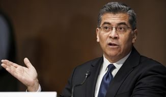 In this Feb. 24, 2021, file photo, Xavier Becerra testifies during a Senate Finance Committee hearing on his nomination to be secretary of Health and Human Services on Capitol Hill in Washington.  (Greg Nash/Pool via AP)  **FILE**