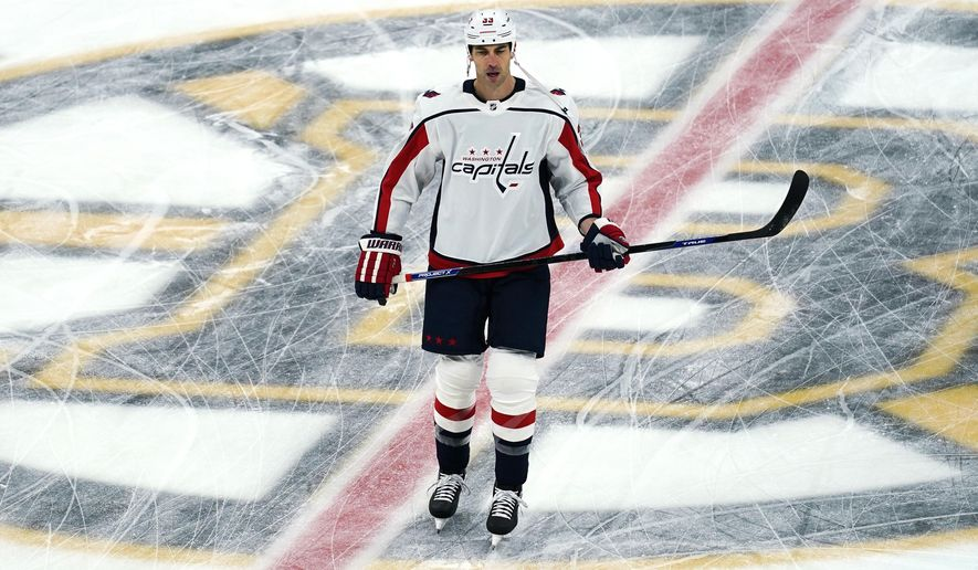 Washington Capitals defenseman Zdeno Chara, skates across the Boston Bruins' logo during a pre-game warm up prior to the first period of an NHL hockey game against his former team, Wednesday, March 3, 2021, in Boston. Chara played for the Bruins from 2006 through the 2020 season. (AP Photo/Charles Krupa)