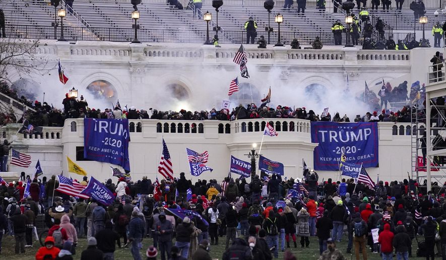 In this Wednesday, Jan. 6, 2021, file photo, rioters storm the Capitol, in Washington. (AP Photo/John Minchillo, File)