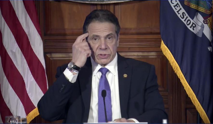 """In this image taken from video from the Office of the N.Y. Governor, New York Gov. Andrew Cuomo speaks during a news conference, Wednesday, March 3, 2021, in Albany, N.Y.  Besieged by sexual harassment allegations, a somber Cuomo apologized Wednesday, saying he """"learned an important lesson"""" about his own behavior around women, but he said he intended to remain in office. (Office of the NY Governor via AP)"""