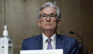 In this Dec. 1, 2020, file photo, Chairman of the Federal Reserve Jerome Powell appears before the Senate Banking Committee on Capitol Hill in Washington. (AP Photo/Susan Walsh, Pool, File)