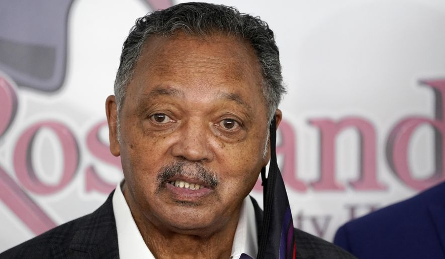FILE - In this Jan. 8, 2021 file photo, Rev. Jesse Jackson speaks before receiving Pfizer's COVID-19 vaccine at the Roseland Community Hospital in Chicago. Jackson was discharged Tuesday, March 2, 2021, from a rehabilitation center where he spent more than three weeks following an illness and surgery.  (AP Photo/Charles Rex Arbogast, File)