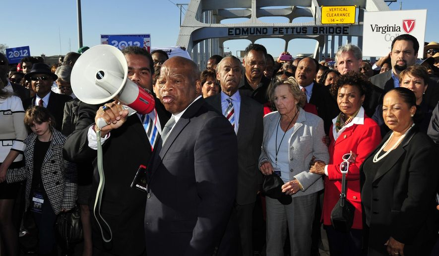 "FILE - In this March 4, 2012, file photo, U.S. Rep. John Lewis, D-Ga., center, talks with those gathered on the historic Edmund Pettus Bridge during the 19th annual reenactment of the ""Bloody Sunday"" Selma to Montgomery civil rights march across the bridge in Selma, Ala. The March 7, 2021, Selma Bridge Crossing Jubilee will be the first without the towering presence of Lewis, as well as the Rev. Joseph Lowery, the Rev. C.T. Vivian and attorney Bruce Boynton, who all died in 2020. (AP Photo/Kevin Glackmeyer, File)"