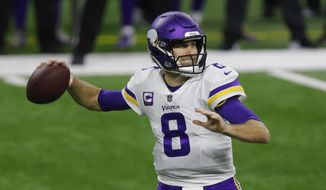 FILE - In this Sunday, Jan. 3, 2021 file photo, Minnesota Vikings quarterback Kirk Cousins throws during the first half of an NFL football game against the Detroit Lions in Detroit. Minnesota Vikings general manager Rick Spielman says the team has no plan to move on from quarterback Kirk Cousins. Spielman's comments were his first on the team's roster since the season ended. (AP Photo/Al Goldis, File)