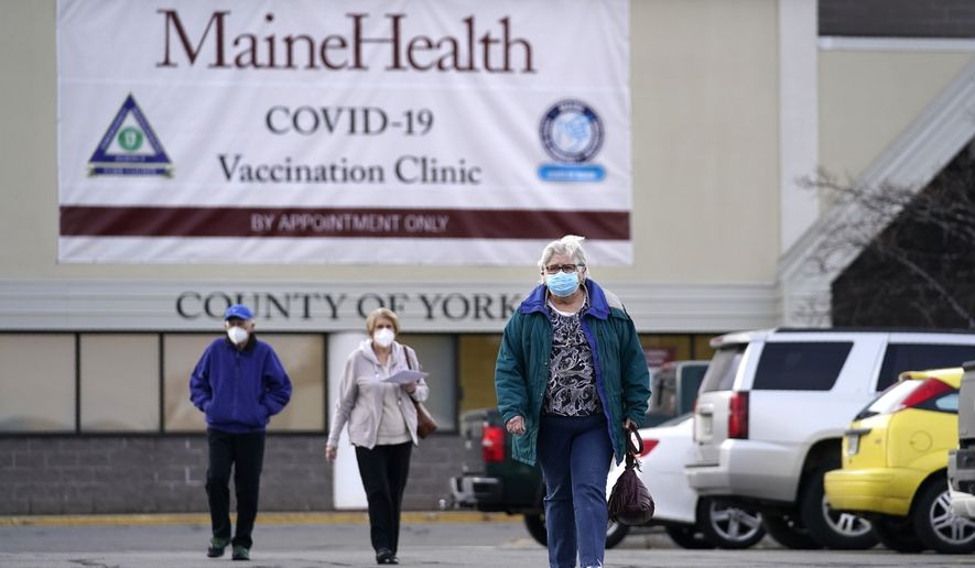 Senior citizens leave a COVID-19 vaccination site operated by Maine Health in the site of a former department store, Wednesday, March 3, 2021, in Sanford, Maine. (AP Photo/Robert F. Bukaty)