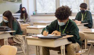 Freshman Nicholas Brown takes a pre-geometry pop quiz with his classmates at Seton LaSalle Catholic High School, Wednesday, March 3, 2021, in the Mt. Lebanon suburb of Pittsburgh. (Emily Matthews/Pittsburgh Post-Gazette via AP)