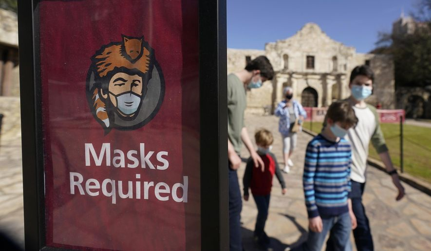 Visitors wearing face masks leave the Alamo, Wednesday, March 3, 2021, in San Antonio. Gov. Greg Abbott says Texas is lifting a mask mandate and lifting business capacity limits next week. (AP Photo/Eric Gay) **FILE**