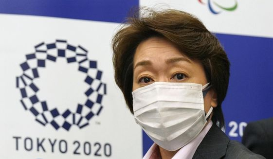 Seiko Hashimoto, president of the Tokyo 2020 Organizing Committee of the Olympic and Paralympic Games (Tokyo 2020), attends a news conference with Toshiro Muto, left, CEO of Tokyo 2020, after a council meeting in Tokyo on Wednesday, March 3, 2021. (Kimimasa Mayama/Pool Photo via AP)