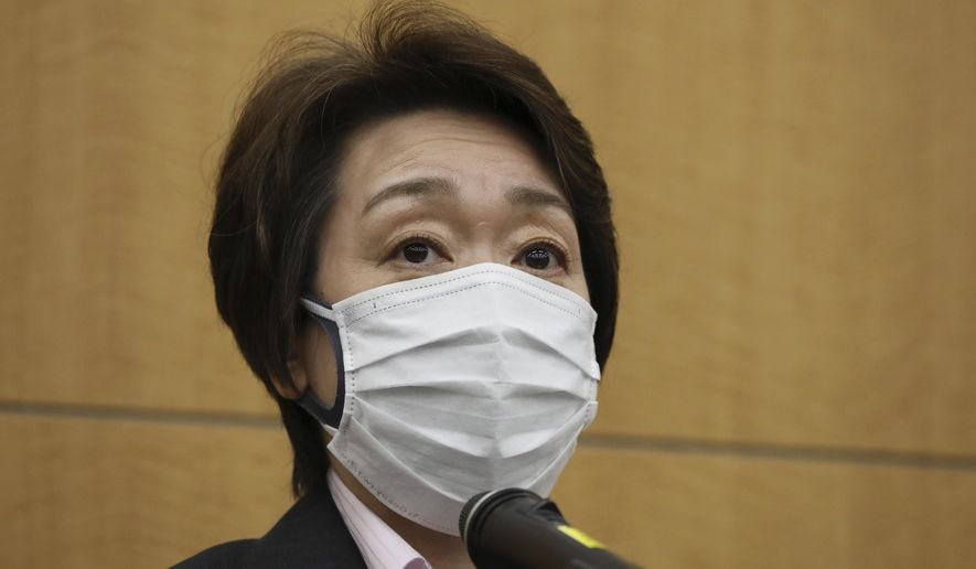 Seiko Hashimoto, president of the Tokyo Organizing Committee of the Olympic and Paralympic Games (Tokyo 2020), speaks before reporters after a five-party meeting at the Tokyo 2020 headquarters in Tokyo on Wednesday, March 3, 2021. (Du Xiaoyi/Pool Photo via AP)
