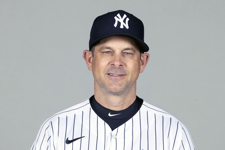 FILE - This is a Feb. 24, 2021, photo showing Aaron Boone of the New York Yankees baseball team. The New York Yankees announced Wednesday, March 3, 2021, that manager Aaron Boone is taking an immediate medical leave of absence to receive a pacemaker. (Mike Carlson/MLB Photos via AP, Pool) **FILE**