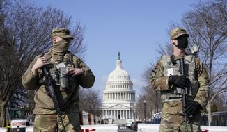 In this file photo, National Guard keep watch on the Capitol, Thursday, March 4, 2021, on Capitol Hill in Washington.  (AP Photo/Jacquelyn Martin)  **FILE**
