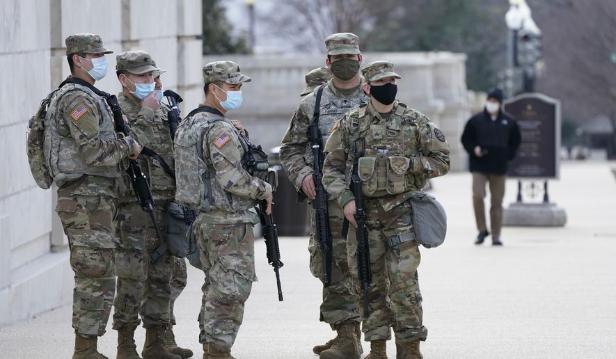 "National Guard keep watch on the Capitol, Thursday, March 4, 2021, on Capitol Hill in Washington. Capitol Police say they have uncovered intelligence of a ""possible plot"" by a militia group to breach the U.S. Capitol on Thursday, nearly two months after a mob of supporters of then-President Donald Trump stormed the iconic building to try to stop Congress from certifying now-President Joe Biden's victory. (AP Photo/Jacquelyn Martin)"