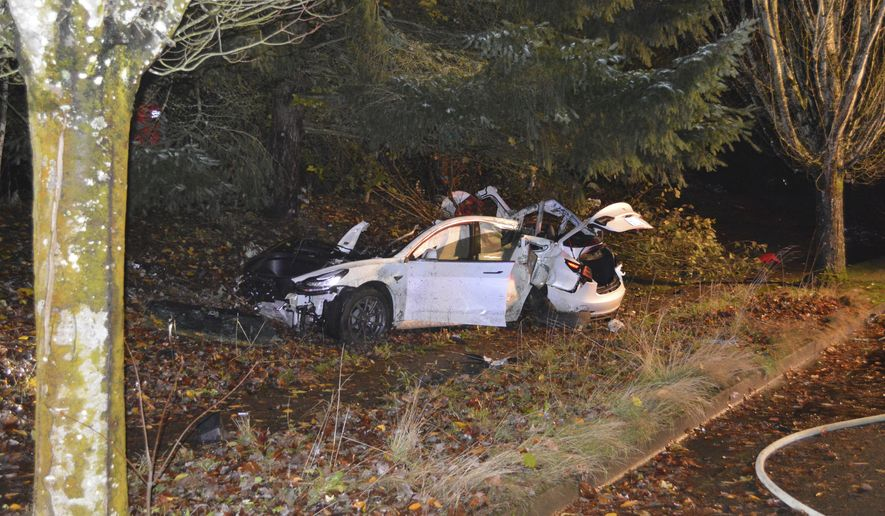 In this Nov. 17, 2020, file photo provided by the Corvallis Police Department is the scene where an Oregon man crashed a Tesla while going about 100 mph, destroying the vehicle, a power pole and starting a fire when some of the hundreds of batteries from the vehicle broke windows and landed in residences in Corvallis, Ore. (Corvallis Police Department via AP, File)