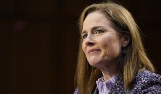 In this Oct. 14, 2020, photo, Supreme Court nominee Amy Coney Barrett speaks during a confirmation hearing before the Senate Judiciary Committee, on Capitol Hill in Washington. (AP Photo/Susan Walsh, Pool) **FILE**