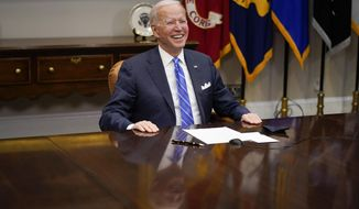 President Joe Biden congratulates NASA's Jet Propulsion Laboratory Mars 2020 Perseverance team for successfully landing on Mars during a virtual call in the Roosevelt Room at the White House, Thursday, March 4, 2021. (AP Photo/Andrew Harnik)