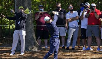 Rory McIlroy, of Northern Ireland, hits from the rough in front of the gallery on the ninth hole during the first round of the Arnold Palmer Invitational golf tournament Thursday, March 4, 2021, in Orlando, Fla. (AP Photo/John Raoux)