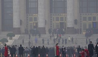 "Delegates arrive at the Great Hall of the People for the opening session of the annual National People's Congress held in Beijing on Friday, March 5, 2021. The ruling Communist Party is aiming for economic growth ""over 6%"" as it rebounds from the coronavirus pandemic, Premier Li Keqiang said in a speech at China's ceremonial legislature Friday. (AP Photo/Ng Han Guan)"